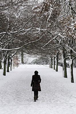 Woman in snowy landscape (II) - p1072m829403 by Neville Mountford-Hoare