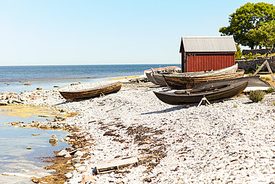 Boats and fishing shed at sea - p312m1070526f by Michael Jonsson