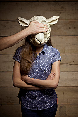 Young woman with animal mask - p586m1007110 by Kniel Synnatzschke