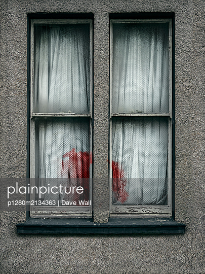 Window with bloody curtain - p1280m2134363 by Dave Wall