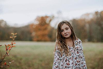 Portrait of confident girl at park - p1166m1555649 by Cavan Images
