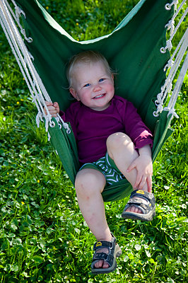 Child on a swing - p116m1586229 by Gianna Schade