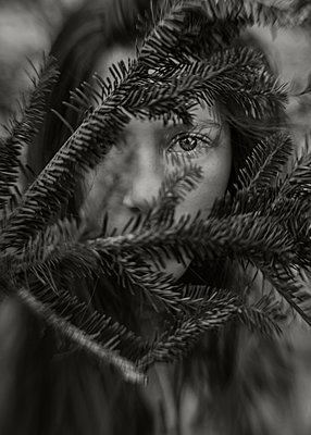 Girl behind a branch - p1503m2031825 by Deb Schwedhelm