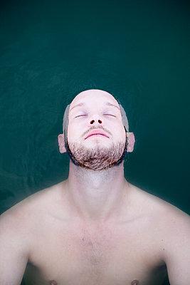 Man in lake - p817m2016108 by Daniel K Schweitzer