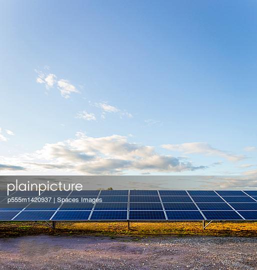 Solar panels under blue sky in remote landscape
