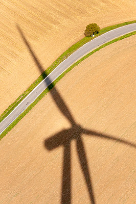 Silhouette of a wind turbine - p1079m891218 by Ulrich Mertens