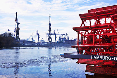 Building cranes in harbour - p312m672778 by Bruno Ehrs