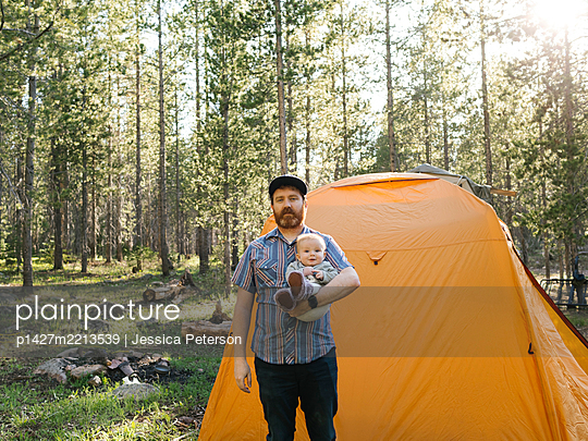 Father with baby boy (6-11 Months) standing by tent in Uinta-Wasatch-Cache National Forest - p1427m2213539 by Jessica Peterson