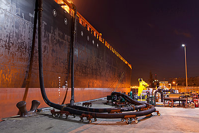 Oil tanker ship docked in industrial harbor - p555m1414143 by Tom Paiva Photography