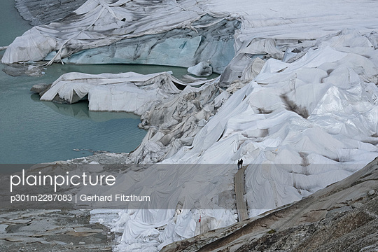 Glacier covered with protective plastic, Canton of Valais, Switzerland - p301m2287083 by Gerhard Fitzthum