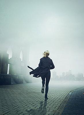 Woman in black coat - p984m2022595 by Mark Owen