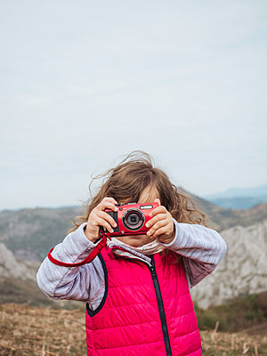 Girl in the nature taking a picture in front of the camera - p1522m2082751 by Almag