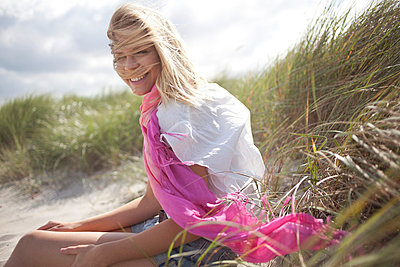 Woman enjoys wind and sun - p6420197 by brophoto