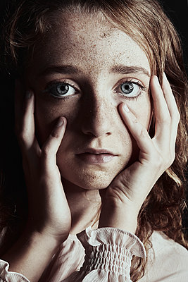 dramatic portrait of a young girl - p1540m2211008 by Marie Tercafs