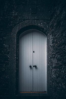 Door on a building - p1681m2283676 by Juan Alfonso Solis