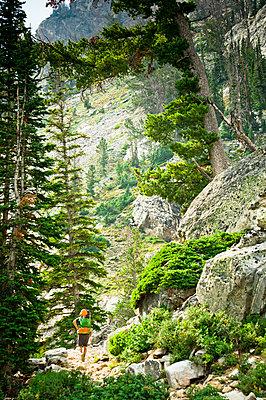 A backpacker going through rocky terrain. - p343m1184706 by Rob Hammer