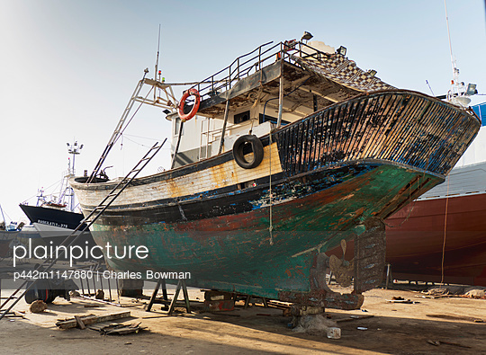 Boat repair in the port; Tangier, Morocco - p442m1147880 by Charles Bowman