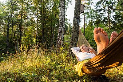 Woman relaxing on hammock - p312m1229220 by Fredrik Schlyter