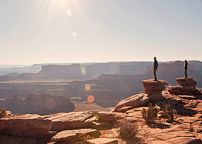Two figures stand at the canyon's edge, Dead Horse Point State Park, Utah. - p343m1130238f by Chris Bennett