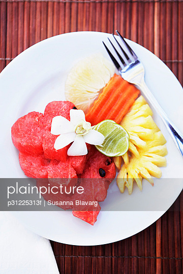 Slices of fruits on plate