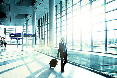 Young business man at airport - p4020363 by Ramesh Amruth