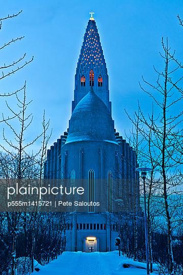 Monument overlooking snowy courtyard, Reykjavik, Hofudborgarsvaedi, Iceland