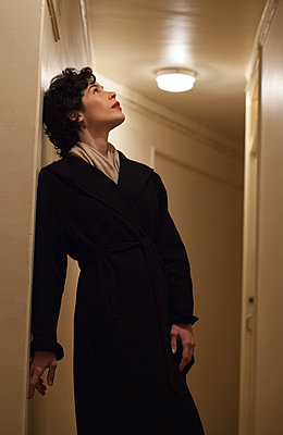 Woman in hallway - p873m2100483 by Philip Provily