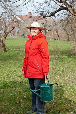 Gardening woman - p956m658558 by Anna Quinn