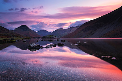 Pink clouds reflected in tranquil Wast Water, dawn, Wasdale, Lake District National Park, UNESCO World Heritage Site, Cumbria, England, United Kingdom - p871m2075285 by Stephen Tomlinson