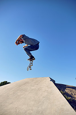 Kickflip on concrete ramp, Montreal, Quebec, Canada, 2018 - p1362m2024424 by Charles Knox