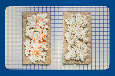 Crispbread with soft cheese, elevated view - p3007159f by Tom Hoenig