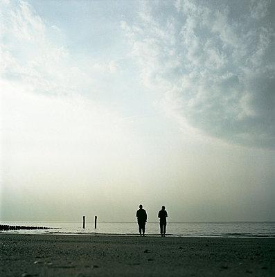 Two men looking far - p7580052 by L. Ajtay