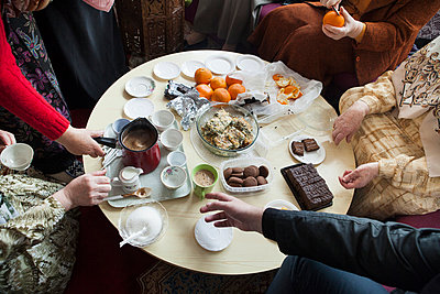 Cropped image of people having breakfast at table - p1185m994410f by Astrakan