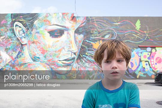 Boy at Wynwood wall Miami - p1308m2065298 by felice douglas