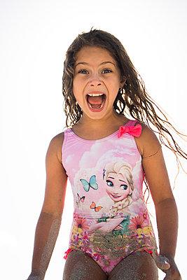 Little girl in swimsuit has fun - p1640m2246118 by Holly & John