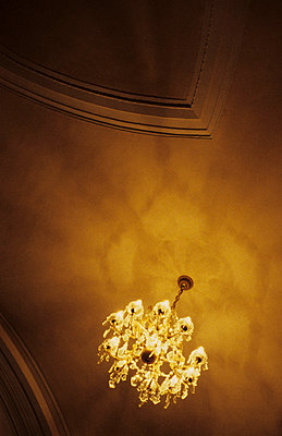 Chandelier on a ceiling - p8570027 by Julia Droop
