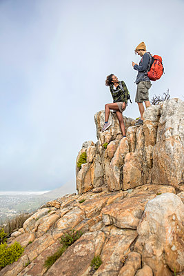Young couple on mountain peak - p1355m1574153 by Tomasrodriguez