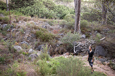 Hiker stands in a clearing - p1640m2261035 by Holly & John