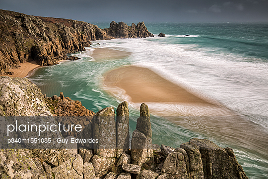 Logan Rock from Treen Cliff, Porthcurno,Cornwall, England, UK. February 2015. - p840m1551085 by Guy Edwardes