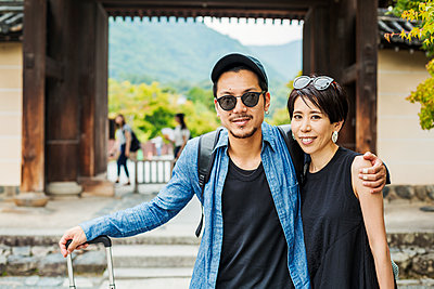 A man and woman visiting a historic temple in Japan. - p1100m1185879 by Mint Images