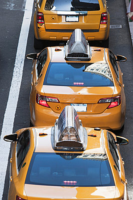 Yellow taxis in a row 42nd Street New York, USA - p924m805856f by Ditto
