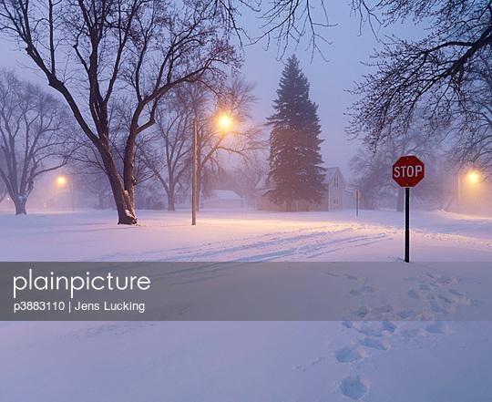 Village in wintry landscape - p3883110 by Jens Lucking