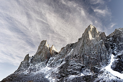 Low angle view of mountain against sky during winter - p1166m1186145 by Cavan Images