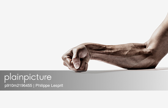 Human muscles, clenched fist - p910m2196455 by Philippe Lesprit
