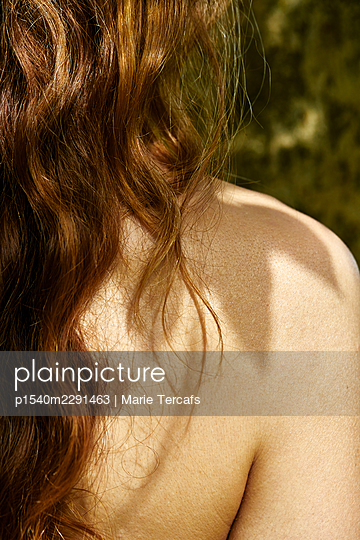 back of long haired redhead woman in nature - p1540m2291463 by Marie Tercafs