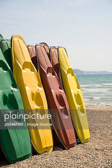 Kayaks on weymouth beach - p9244166f by Image Source