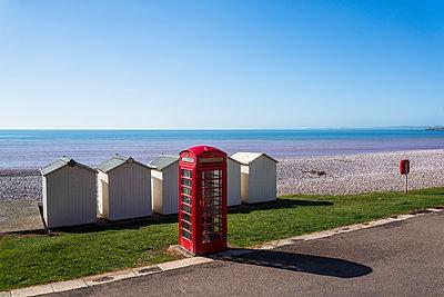 Red phone box at the seaside - p1170m1137544 by Bjanka Kadic