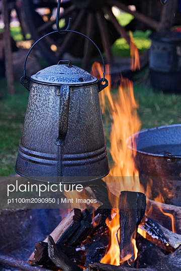 Coffee Pot Over an Open Fire - p1100m2090950 by Mint Images