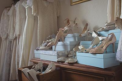 Wedding dresses and footwears in boutique - p1315m1421955 by Wavebreak
