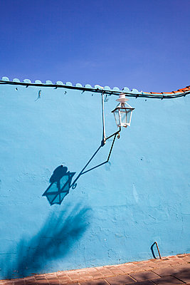 Old lantern with shadow - p304m1093922 by R. Wolf